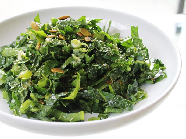 kale salad with pumpkin seeds and golden raisins