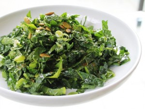 kale salad with pumpkin seeds and golden raisins